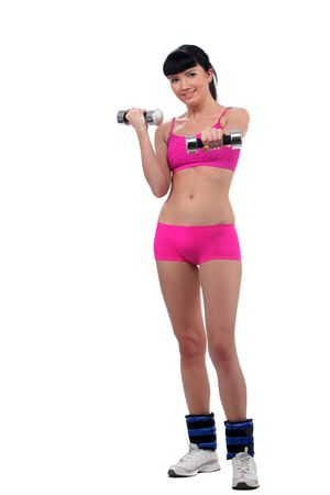 Girl doing exercises with dumbbell photo