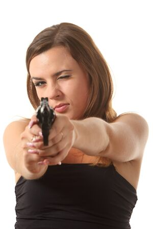 Beatuifull young girl is aiming a revolver photo