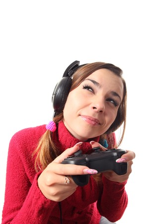 vexation: Girl play computer game with helping of a gamepad