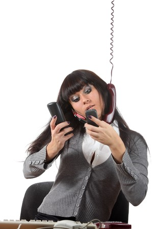 Businesswoman speak by four phones at the same time on her workspace Stock Photo - 8040306
