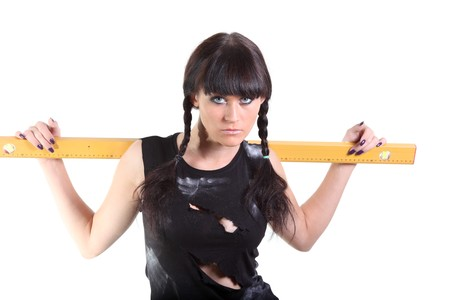 Girl in a ragged t-shirt hold a yellow ruler Stock Photo - 8040298