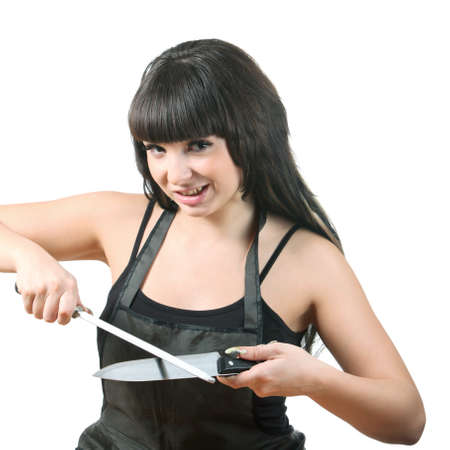 Young brunette women sharpen knife with using grinder photo