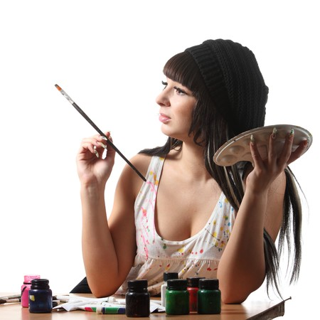 Young women-artist hold brush and palette and thinking photo