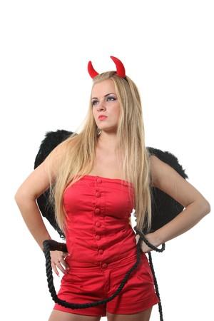 Femme blonde de jeunes sexi dans un costume de diable rouge  Banque d'images