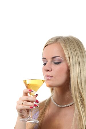 Luxuriously young blond woman drink Martini Stock Photo