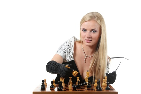 Young glamour blond woman play chess