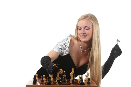 pawn adult: Young glamour blond woman end the chess game by a checkmate Stock Photo