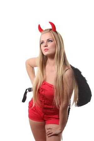 Femme blonde de jeunes sexi dans un costume de diable rouge