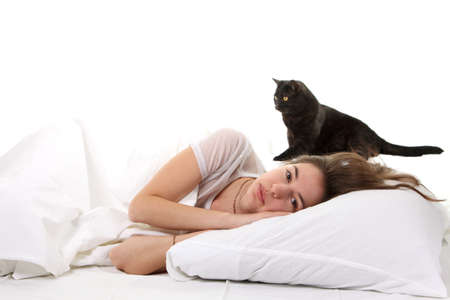 Woman in a bed with her black cat Stock Photo