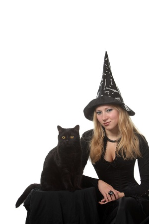 A young woman in a witch costume with a black cat photo
