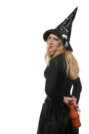 A young woman in a witch costume Stock Photo - 8406432