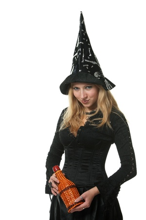 A young woman in a witch costume photo