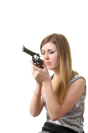 Young woman reload a revolver Stock Photo - 8406458