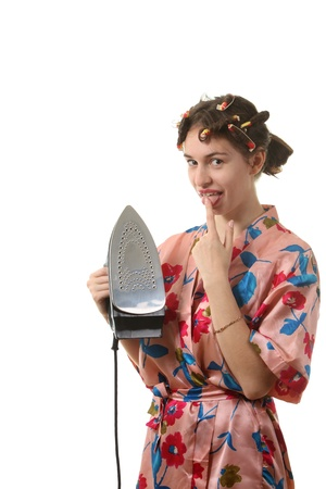 Attractive housewife with iron photo