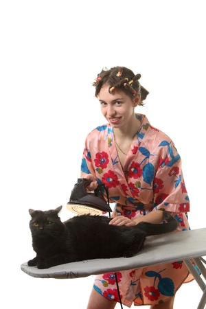 Attractive housewife ironing a black cat photo