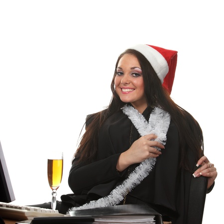 Young businesswoman in a christmas hat photo