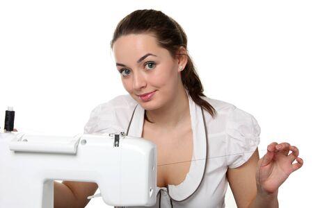 maquinas de coser: Trabajo de costurera de la mujer en la m�quina de coser