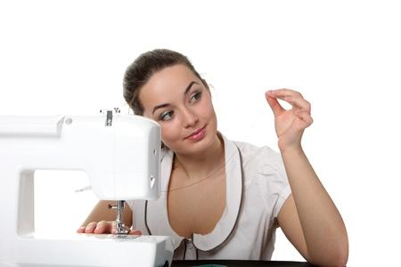 Trabajo de costurera de la mujer en la máquina de coser Foto de archivo - 8589396