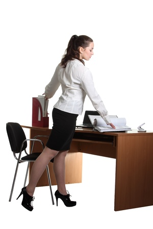 Businesswoman work on her workspace Stock Photo - 8873552
