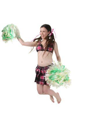 tailes: Attraente giovane ragazza sottile cheerleader salto