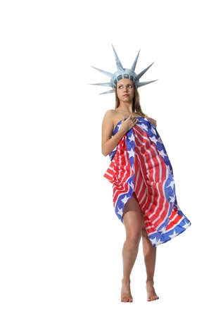 Attractive blond woman in costume Statue of Liberty