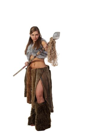 savage: Young attractive girl in costume of savage woman attack by a spear Stock Photo