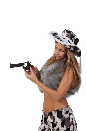 Pretty young girl in the cowboy costume with revolver