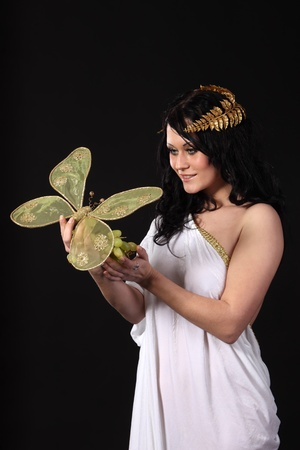 Ancient godness with a bunch of grapes and a big butterfly Stock Photo - 9185294