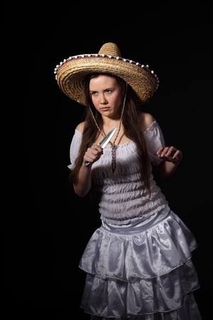 Anger mexican girl hold a knife photo