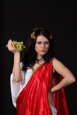 Ancient godness with a bunch of grapes photo