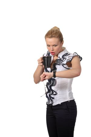 Attractive young businesswoman with a cup of tee photo
