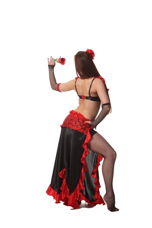oriental ethnicity: Young attarctive girl dance tribal with a red rose