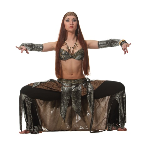 Woman in a snake costume dance in a tribal style