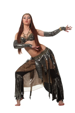 oriental girl: Woman in a snake costume dance in a tribal style