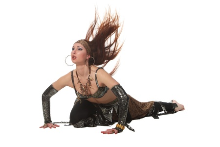 belly dancing: Woman in a snake costume dance in a tribal style