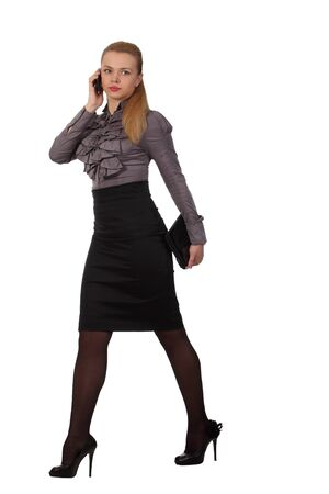 Young businesswoman with laptop speak phone photo