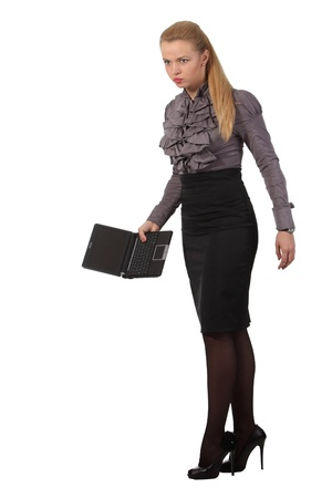 Young angry businesswoman hold a notebook photo