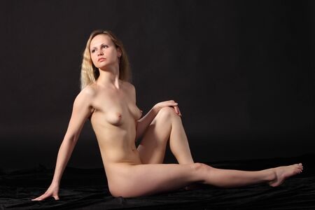 Young attractive naked woman. Studio shot Stock Photo - 9884285