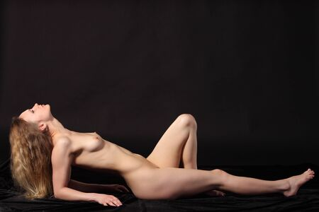 Young attractive naked woman. Studio shot Stock Photo - 9884287