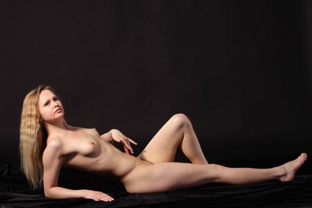 Young attractive naked woman. Studio shot Stock Photo - 9884284