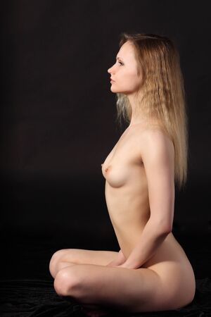 Young attractive naked woman. Studio shot Stock Photo - 9884289