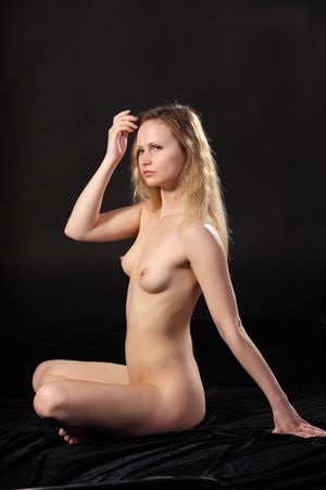 Young attractive naked woman. Studio shot