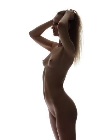 The silhouette of young attractive naked woman Stock Photo