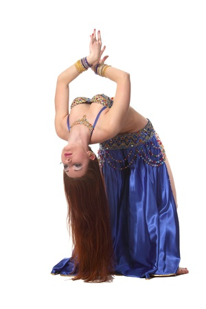 Young beautiful belly dancer in a blue costume Banque d'images