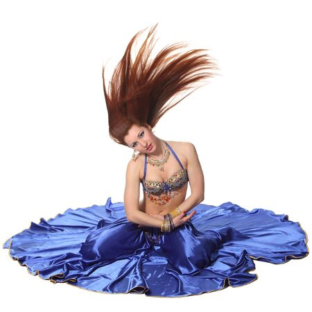 Young beautiful belly dancer in a blue costume Stock Photo - 9884276