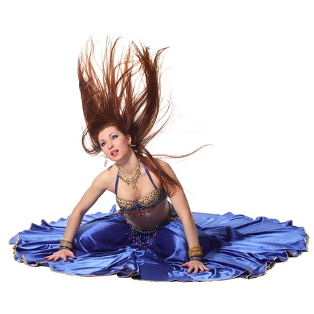 Young beautiful belly dancer in a blue costume photo