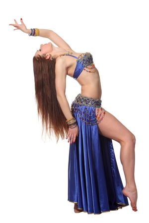 oriental ethnicity: Young beautiful belly dancer in a blue costume Stock Photo