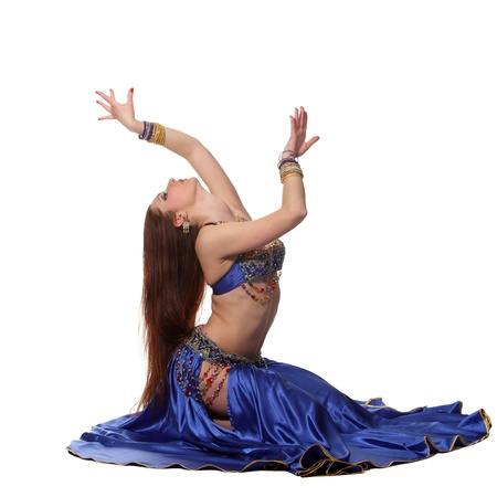 exotic dancer: Young beautiful belly dancer in a blue costume Stock Photo
