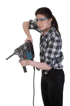 perforator: Young girl in a glasses hold a perforator Stock Photo