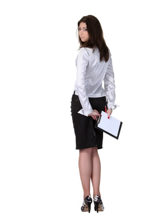 Young attractive businesswoman with a notepad turn back photo